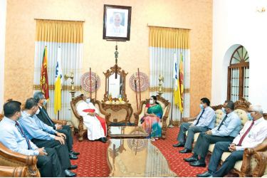 Health Minister Pavithra Wanniarachchi along with Health Officials with Cardinal Malcolm Ranjith.