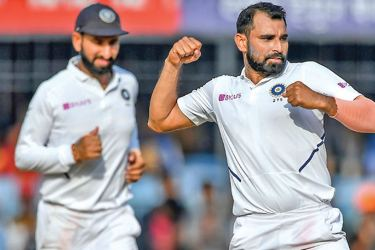 Mohammed Shami (R) is part of a potent Indian pace attack. - AFP