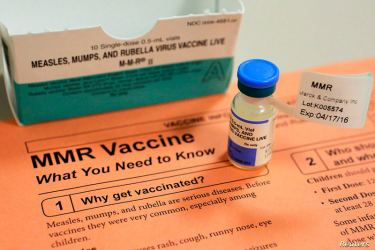 A vial of measles, mumps and rubella vaccine and an information sheet is seen at Boston Children's Hospital in Boston, Massachusetts February 26, 2015.