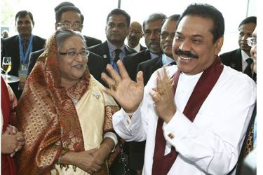 Bangladeshi Prime Minister Sheikh Hasina with former President Mahinda Rajapaksa during the Commonwealth Heads of Government Meeting in Perth in 2011.