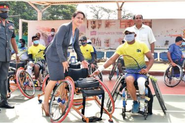 CICT General Manager – Commercial and Marketing Ms Catriona Jayasundara presents one of the wheelchairs to a recipient