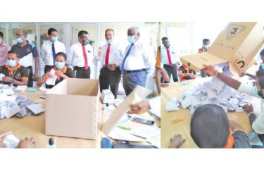 Officers engaged in counting ballot papers at the mock counting held in Galle yesterday. Pictures by Mahinda. P. Liyanage, Galle Central special corr