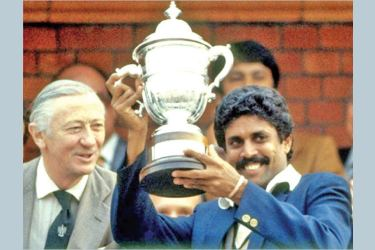 Indian captain Kapil Dev celebrating their 1983 World Cup victory with the trophy