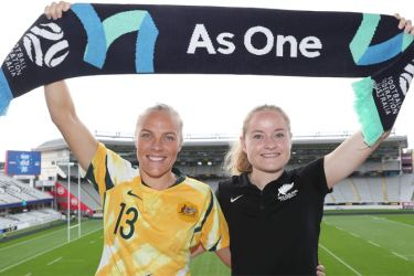Tameka Yallop of Australia (L) and Paige Satchell of New Zealand (R) pose for photographs at Eden Park in Auckland on June 26, 2020, after Australia and New Zealand won hosting rights for the 2023 Women's football World Cup.  AFP