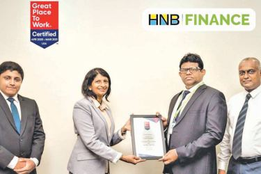 HNB Finance Managing Director Chaminda Prabhath receives the Great Place to Work certification.