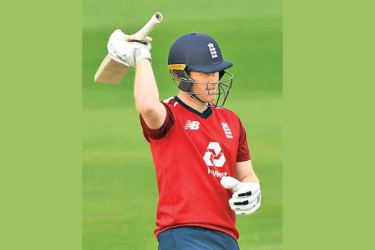 Eoin Morgan of England celebrates reaching  fifty during the 2nd Vitality International Twenty20 match against Pakistan at Emirates Old Trafford on Sunday. - AFP