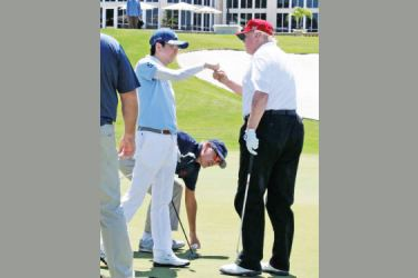 US President Donald Trump and Japanese Prime Minister Shinzo Abe fist-pumping after a round of Golf at the Trump International Golf Club in West Palm Beach in April 2018.