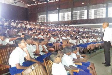 HelpAge Programme Director G.C. Mendis addressing students at D.S.Senanayake College Auditorium.