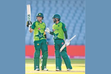 Pakistan's Haider Ali (L) celebrates hitting 50 not out with Pakistan's Mohammad Hafeez during the international Twenty20 cricket match between England and Pakistan at Old Trafford cricket ground in Manchester, north-west England, on September 1. AFP