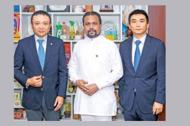 HIPG Company officials with Minister Weerawansa