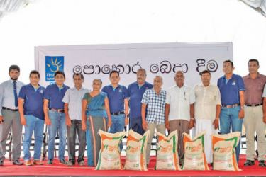 DPL Top management and officials from Rubber Research Institute with rubber farmers who received fertilizer under the DPL Firstlight initiative