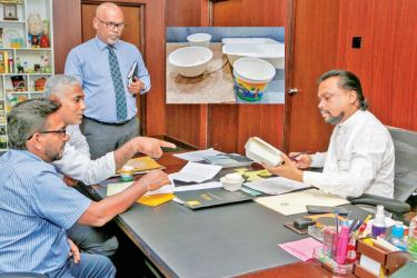 Minister of Industries Wimal Weerawansa examining the packaging.