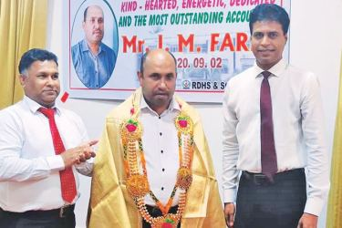 Accountant I.M.Faris being felicitated.