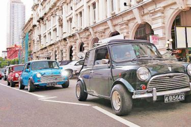 A vintage car rally was held in Colombo yesterday. Here several old mini cars taking part in the rally. Xinhua