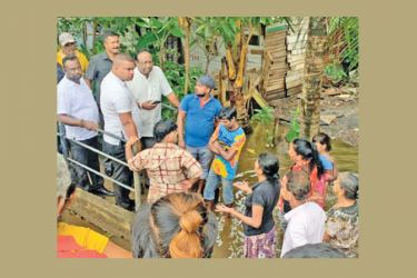 Provincial Councils and Local Government State Minister Admiral Sarath Weerasekara visited Kolonnawa which was inundated due to torrential rains during the last two days. He spoke with residents in the area and promised to look into their grievances.