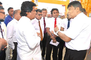 State Minister Jayantha Samaraweera in discussion with Port officials.