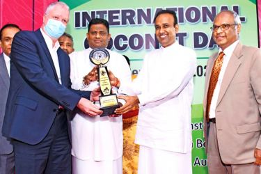Fabrice Cavallin, Managing Director, Nestlé Lanka PLC receives the award from  Arundika Fernando, State Minister - Ministry of Plantations;  Dr. Ramesh Pathirana - Minister of Plantations; and Jayantha Wickramasinghe - Chairman of the Coconut Development Authority, the Coconut Cultivation Board and the Coconut Research Institute.