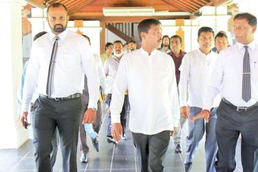 "Minister Prasanna Ranaweera and Ministry officials visiting the ""Ape Gama"" premises."