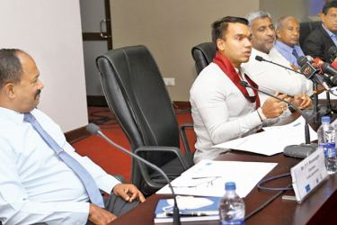 (Second left): Sports Minister Namal Rajapaksa addressing the media while Minister of Tourism Prasanna Ranatunga (centre) and other officials look on. Picture by Sulochana Gamage