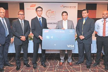 Presentation of the Co-Branded DFCC VISA Debit Card. From Left to Right : Sunil Leeniyagoda, Director/Group Treasurer Prima Ceylon, MRavindra de Coonghe, Head of Sales and Marketing Prima Ceylon, Ong Jhon Seon, General Manager, Prima Ceylon, Lakshman Silva, Chief Executive Officer, DFCC Bank, Denver Lewis, Vice President/Head of Cards DFCC Bank, Jude Muttiah, Senior Manager/Branch Manager, Fort Super Grade Branch, DFCC Bank