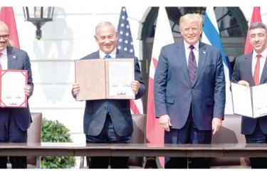 (L-R) Bahrain Foreign Minister Abdullatif al-Zayani, Israeli Prime Minister Benjamin Netanyahu, US President Donald Trump, and UAE Foreign Minister Abdullah bin Zayed Al-Nahyan hold up documents after participating in the signing of the Abraham Accords where Bahrain and the United Arab Emirates recognize Israel. The Abraham Accords were signed at the White House in Washington, DC, on September 15, 2020. - AFP