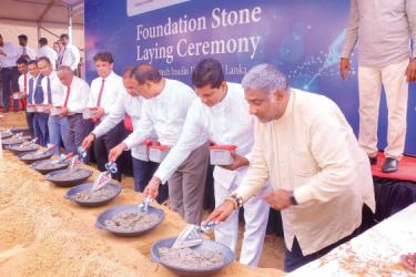 Representatives laying the foundation stone. Picture by Wimal Karunathilake