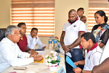 State Minister Siripala Gamlath at the mobile service to settle land disputes.