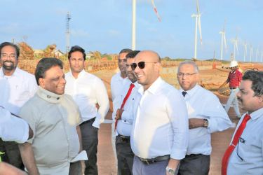 Power Minister Dullas Alahapperuma  and State Minister Duminda Dissanayake at the project site. Picture by Nimal Wijesinghe
