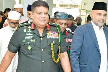 Defence Staff Chief and Army Commander Lieutenant General Shavendra Silva is being escorted to the ritual.