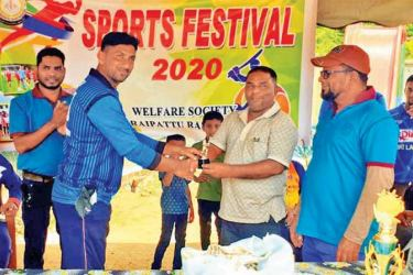The skipper of Win Star Team of Akkaraipattu Base Hospital receiving the trophy from Akkaraipattu Base  Hospital Welfare Society President Dr. A.C.Abdul Razzak.