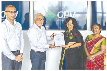 Siddhika G. Senaratne, Director General of Sri Lanka Standards Institution (SLSI) hands over the certificate to GPV Electronics in Sri Lanka.