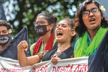 Students shout slogans to protest against an alleged gang-rape and stripping and torturing of a woman in the southern district of Noakhali. - AFP