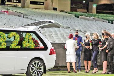 Dean Jones was farewelled in a poignant final lap of an empty Melbourne Cricket Ground