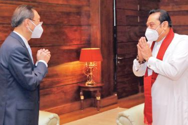 Former Chinese Foreign Minister and the current Communist Party Political Bureau Member Yang Jiechi paying a courtesy call on Prime Minister Mahinda Rajapaksa in Colombo yesterday. Picture courtesy Prime Minister's Media Division