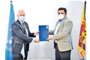 UNDP Resident Representative in Sri Lanka Robert Juhkam and VTA Chairman Damitha Wickramasinghe exchanging documents at the MoU signing ceremony.