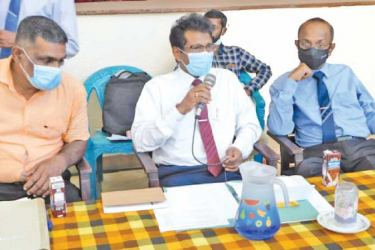 District Secretary D.M.L. Bandaranayake addressing the Irrigation Officials and farmers.