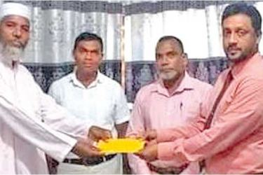A beneficiary receiving a cheque.