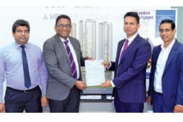 SLT Chief Enterprise & Wholesale Officer Janaka Abeysinghe, SLT CEO Kiththi Perera, Braybrooke Residential Towers (BRT) Director Nayana Mawilmada, and BRT Director Y. H. Rushanka S. Silva