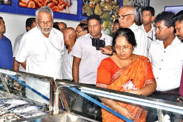 Fisheries Minister Douglas Devananda inspecting one of the Ceylon Fisheries Corporation sales outlets.