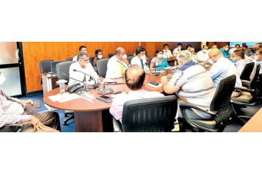 Ministry Secretary Sirinimal Perera and officials at the discussion yesterday.