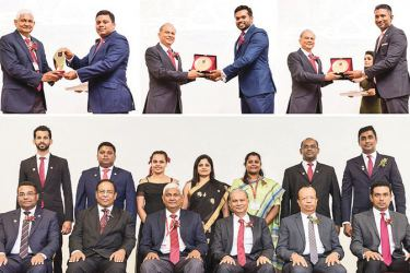 Above: Ceylinco Life Chairman R. Renganathan presenting an award to Mathanraj Sivalingam, while the company's Managing Director Thushara Ranasinghe presents awards to Messrs Chulaka Kumarasinghe and Gayan Lakmal Alwis respectively. Below: The new Executive Committee of Ceylinco Life's Toastmasters Club, with the senior management.