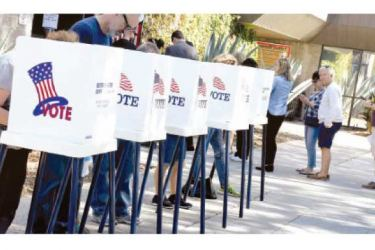 Long lines of voters queue up to cast their ballots on the first day of early voting in Texas on Tuesday.