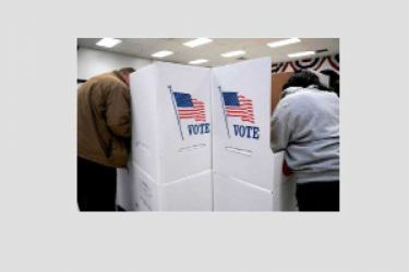 Voters stand at voting booths during early voting at the Oklahoma Election Board in Oklahoma City.