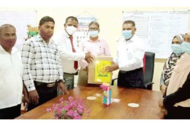 Coordinator for Kalmunai Regional Ayurvedic Hospitals and Nintavur Ayurvedic District Hospital Medical Superintendent Dr. M.A. Nafeel handing over the 'unani' drinks to Sammanthurai Divisional Secretary S.L.M. Haniffa. Picture by Picture by I.L.M. Rizan, Addalaichenai Central Corr.