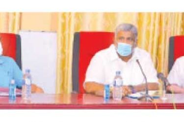 Minister Prasanna Ranatunga (centre) along with other officers addressing the meeting.