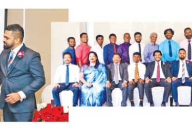 Lanka Shakthi Technologies team and LST MD Gihan Ratnayake presenting an award for best performing staff
