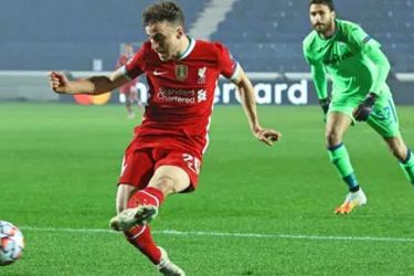 Diogo Jota slots the ball home for his hat-trick in Liverpool's 5-0 thrashing of Atalanta. Mohamed Salah and Sadio Mané also got on the scoresheet.