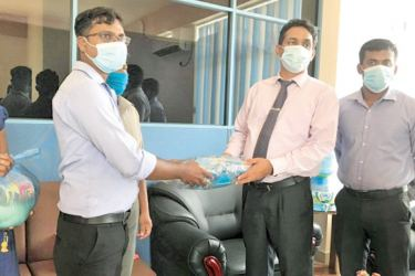 Mannar Government Agent S. Gunabalan receiving the goods from the the DMC.