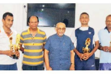 Winners & runners-up with their trophies (from left): M. Lalith, M.A.C. Perera, Tissa Ratnayake, Chairman-Tournament Committee, Benny Perera, President-Kandy Garden Club, Dr. M.Zaffarullax, Lalith Silva and Manjula Amaratunge.