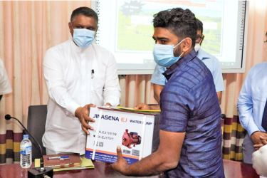 Plantation State Minister Kanaka Herath presenting financial and other subsidies for the establishment of tea nurseries.